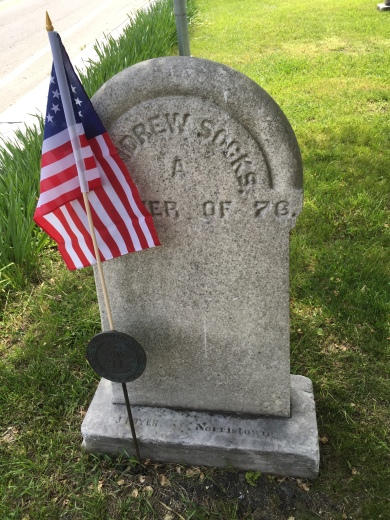Tombstone of Andrew Sockes, Member of 76, with Revolutionary War medal